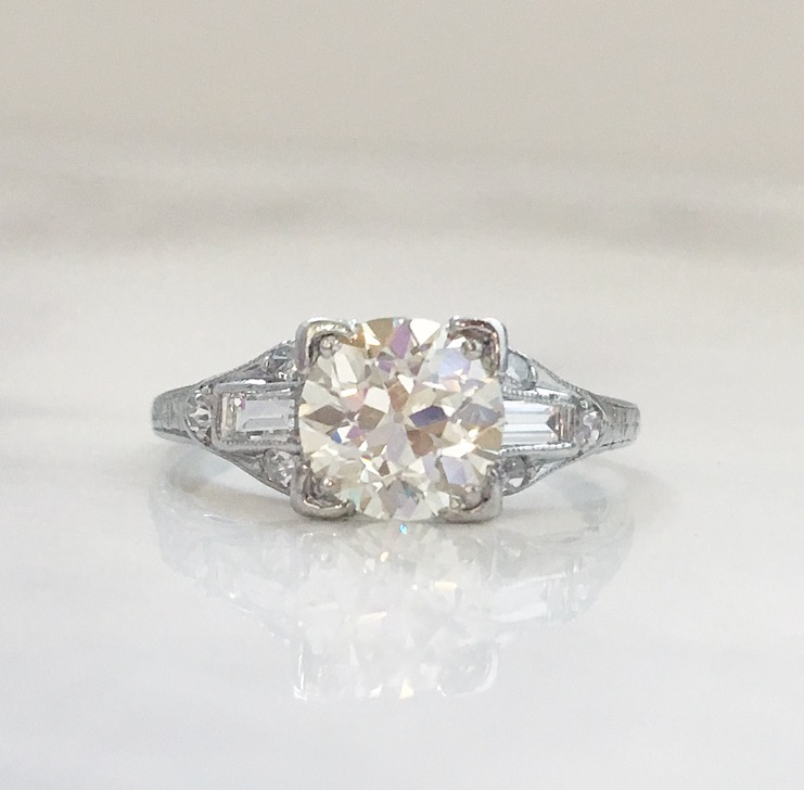 Elegant and timeless Art Deco platinum diamond ring featuring a 1.18 carat Old European cut diamond in the center with 0.40 carats total weight in accent diamonds.  Shop this ring HERE