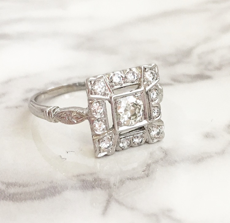 SOLD - An Old European cut diamond with a 1950's twist! The ring features a center 0.30 carat Old European cut diamond set in a lovely 14K white gold 1950's diamond setting. Shop this ring  HERE