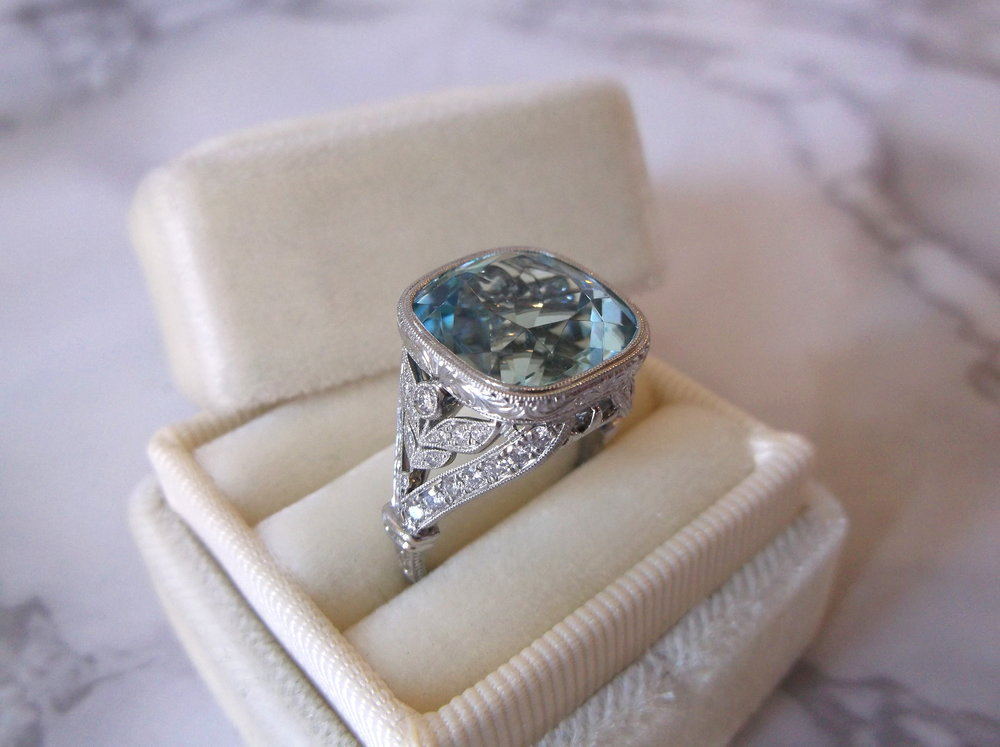 The perfect something blue! The center 9.73 carat aquamarine was originally set in an Edwardian era broach, and now finds its new home in this fabulous hand crafted platinum and diamond mounting with gorgeous hand engraved details.   Shop this ring  HERE