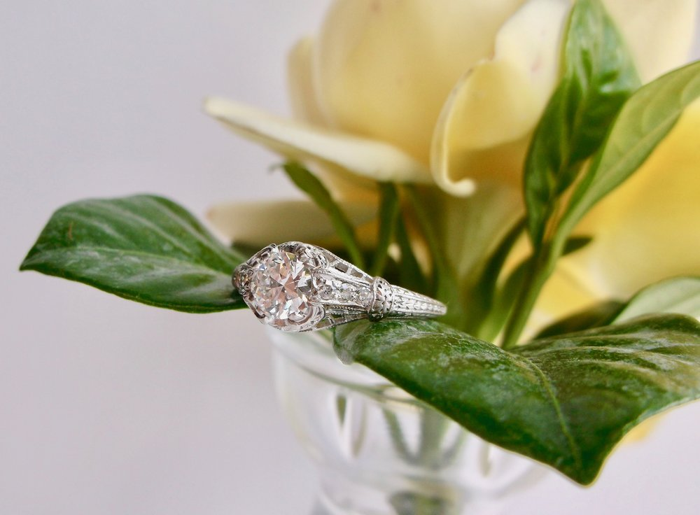 It's all in the details! We're in love with this gorgeous 1920's diamond and platinum ring featuring a 0.57 carat Old European cut diamond in the center (that's a D in color!) with lovely filigree, engraving and diamond details in the setting. Shop this ring  HERE