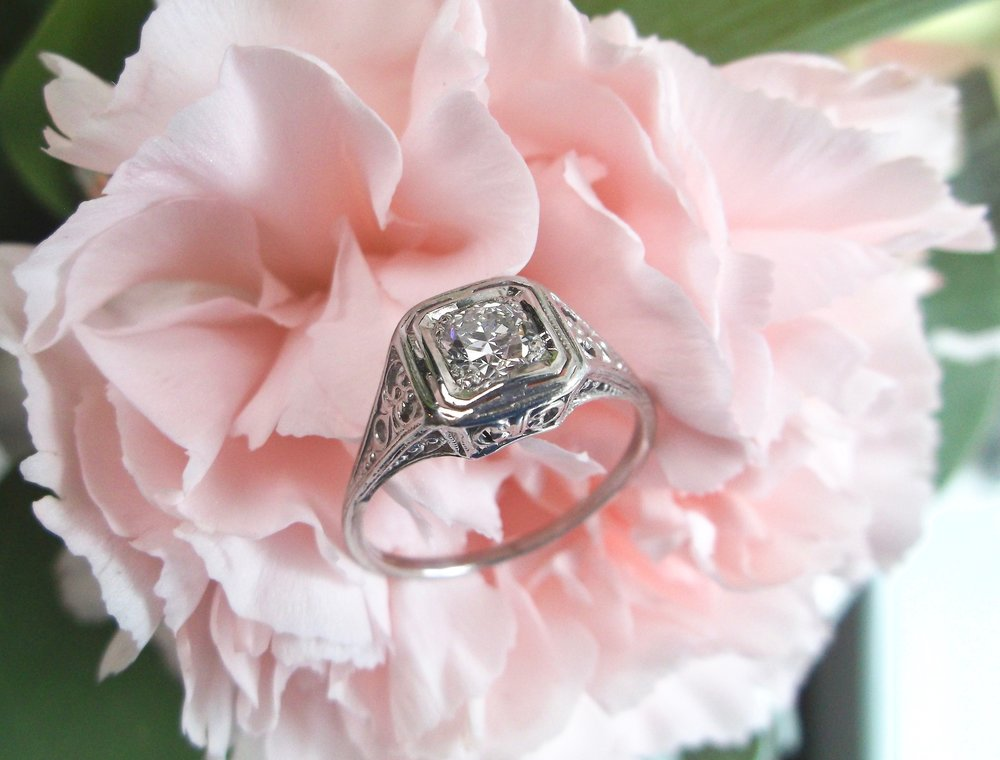 We are loving the intricate details in this 1920's Old European cut diamond ring! The ring features a 0.40 carat Old European cut diamond in the center, set in a beautiful filigree platinum mounting. Shop this beautiful ring  HERE