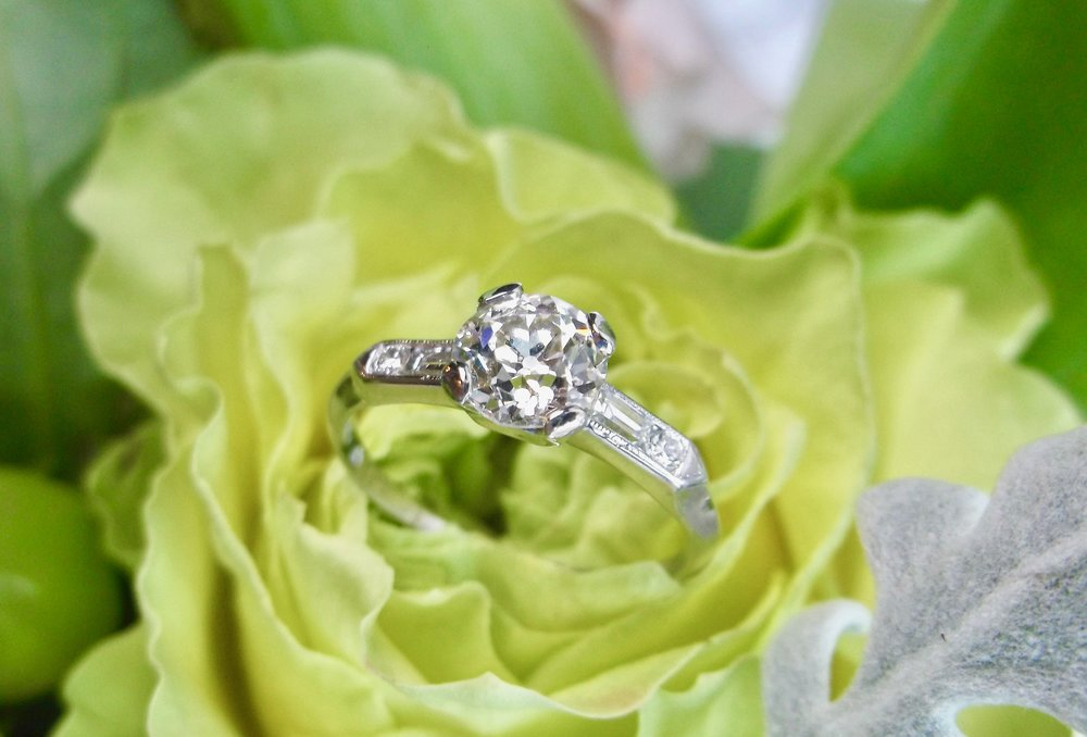 A timeless beauty! 1920's diamond and platinum ring, featuring a center 0.83 carat Old European cut diamond with baguette and round accent diamond details. Shop this lovely ring  HERE .