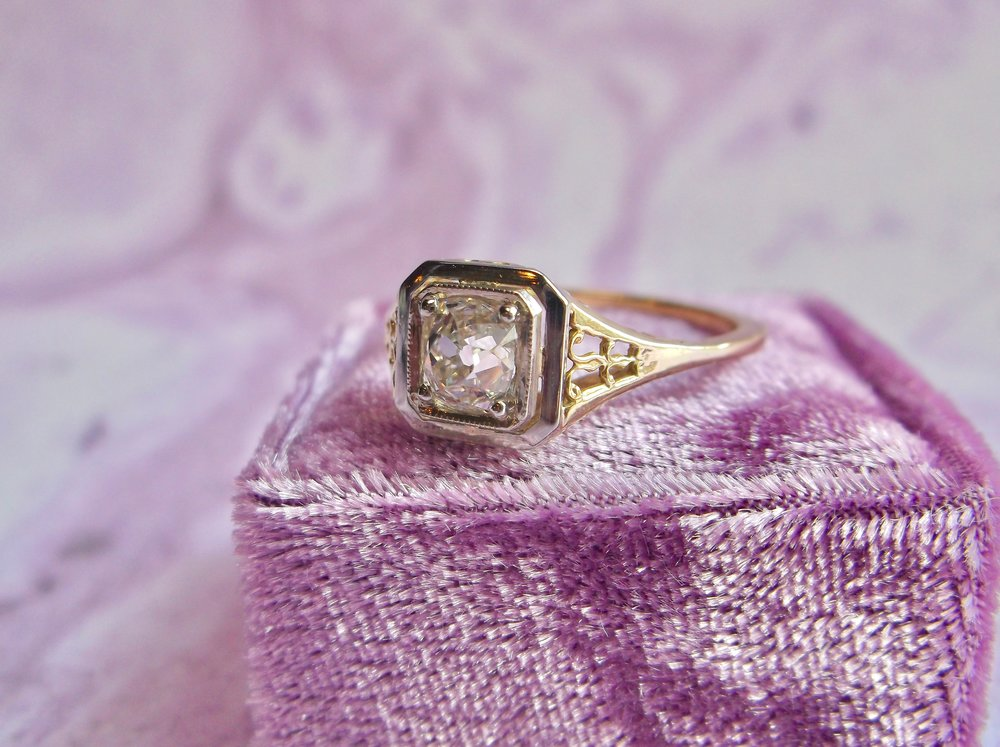Beautifully timeless Victorian era Old Mine cut diamond ring. The ring features a 0.65 carat Old Mine cut diamond, set in a two tone yellow gold and white gold filigree setting. Shop this beauty  HERE .