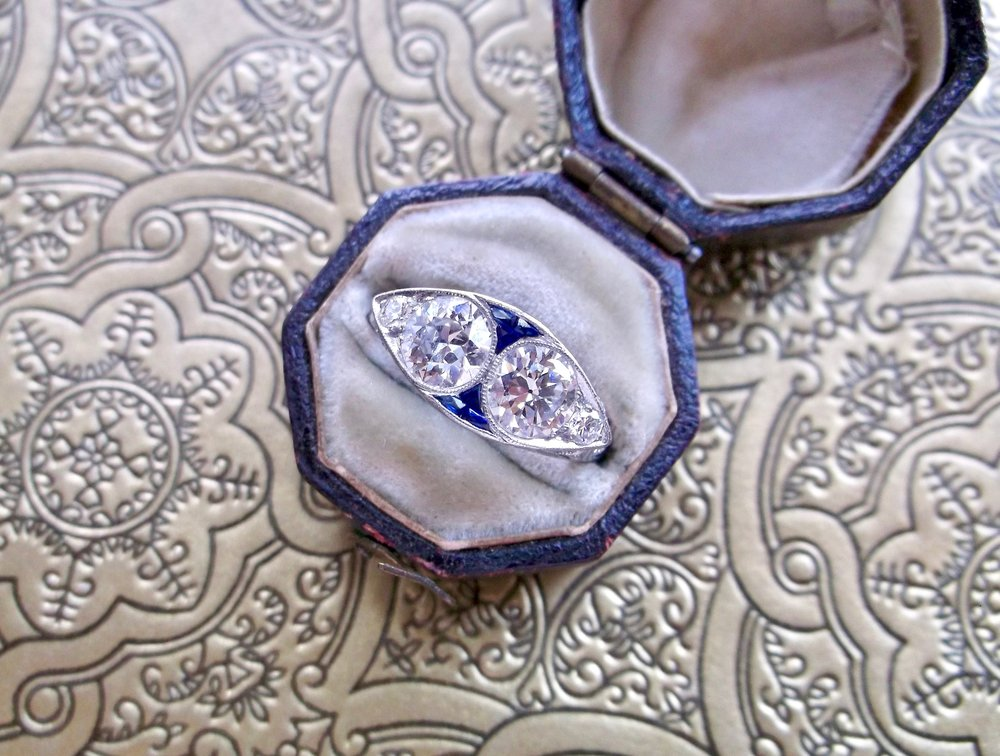 Add a little pop of color with this fabulous Art Deco Old European cut diamond and sapphire ring! Shop this beauty  HERE .