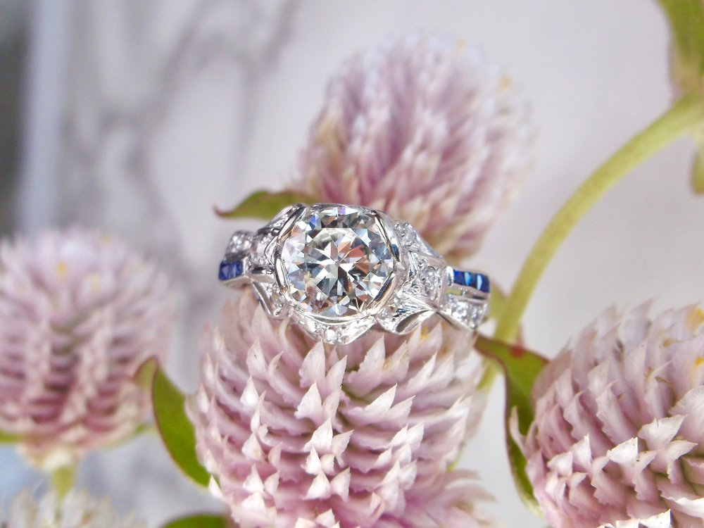 Just the right amount of sapphire accents in this beautiful Art Deco diamond ring! The ring features a center 1.18 carat Old European cut diamond.  Shop this beauty  HERE .