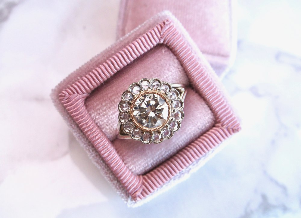 Fabulous Old European cut diamond, rose cut diamond, 18K white gold and 22K yellow gold ring.  The ring features a center 1.36 carat Old European cut diamond set in a 22K yellow gold bezel with milgrain details, surrounded by 0.50 carats in rose cut diamonds (VS1 clarity, G color). Shop this beauty  HERE .