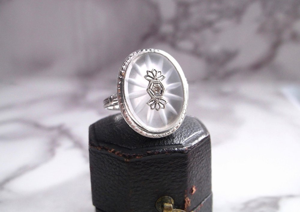We adore this lovely carved quartz ring that features an Old Mine cut diamond in the center that appears to be radiating beauty!  Shop this ring  HERE .