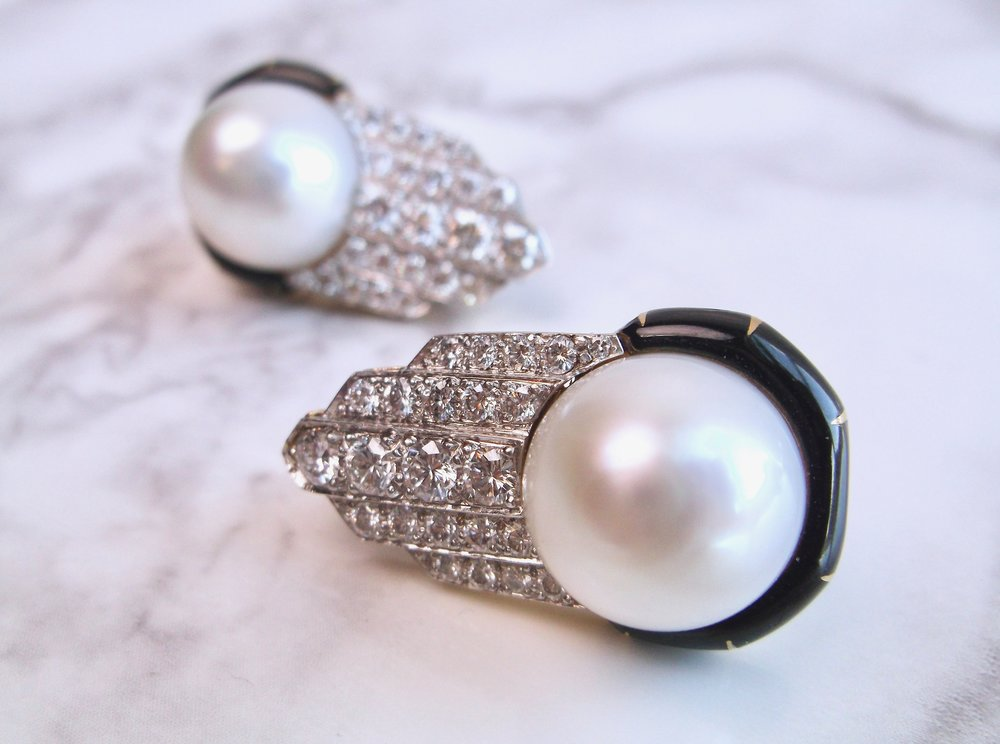 Fabulous pearl, diamond and enamel earrings by none other than David Webb. Shop these stunners  HERE .