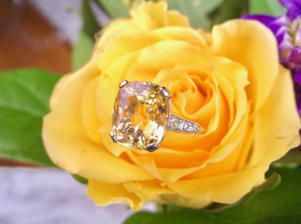 Like a welcoming ray of sunshine, this stunning 5.85 carat yellow sapphire and diamond ring is sure to brighten your day! Shop this fabulous piece  HERE .
