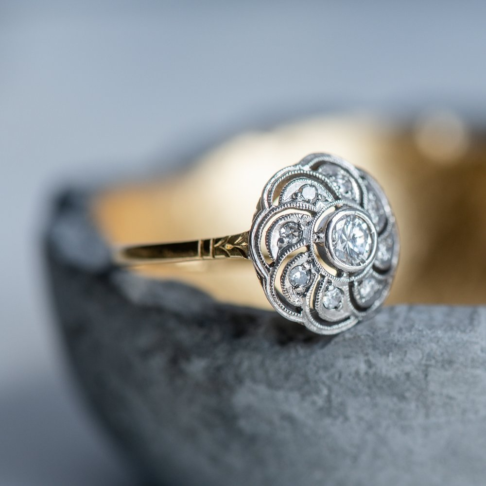 Whimsical platinum topped gold and diamond ring (and there's even earrings to match!) Shop this lovely ring  HERE  and the matching earrings  HERE .
