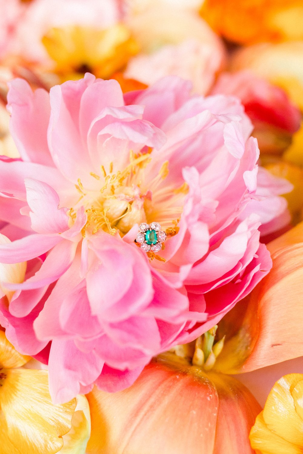 A flower amongst flowers! Shop this fabulous Victorian era emerald and Old Mine cut diamond ring  HERE .  Photography by Morgan Franklin Creative.