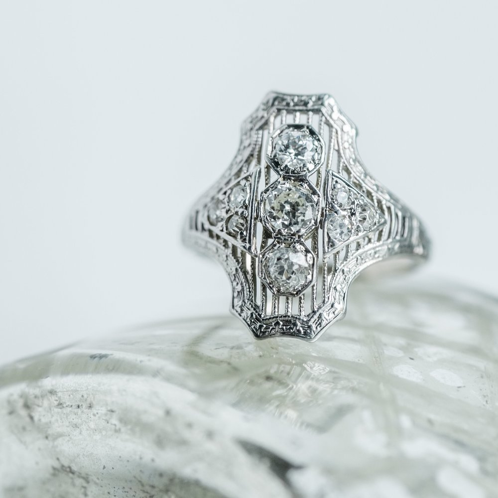 Fabulous Art Deco diamond and filigree ring featuring one carat total weight in diamonds! Shop this beauty  HERE .