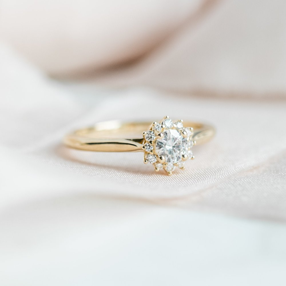 Sweet diamond cluster ring in yellow gold.  Shop this ring  HERE .