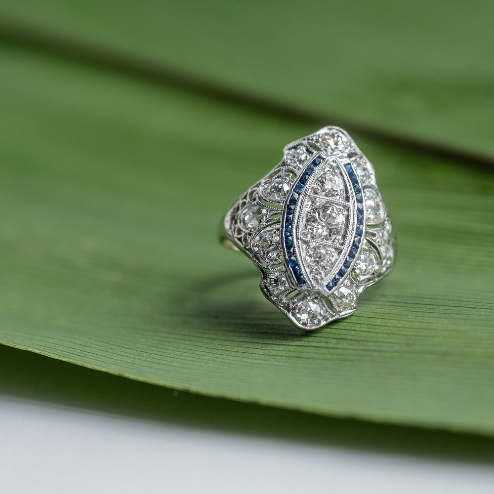 Fabulous Art Deco diamond and sapphire ring featuring 1.50 carats of Old European cut diamonds, beautifully accented by french cut sapphires.  Shop this ring  HERE .