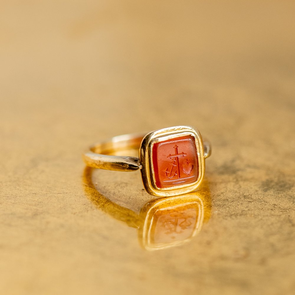 """Faith, Hope and Charity"" beautifully portrayed on this lovely Victorian era carnelian intaglio ring. Shop  HERE ."