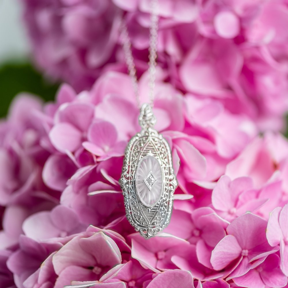 Filigree, diamond and carved quartz pendant sure looks pretty in pink! Shop  HERE .