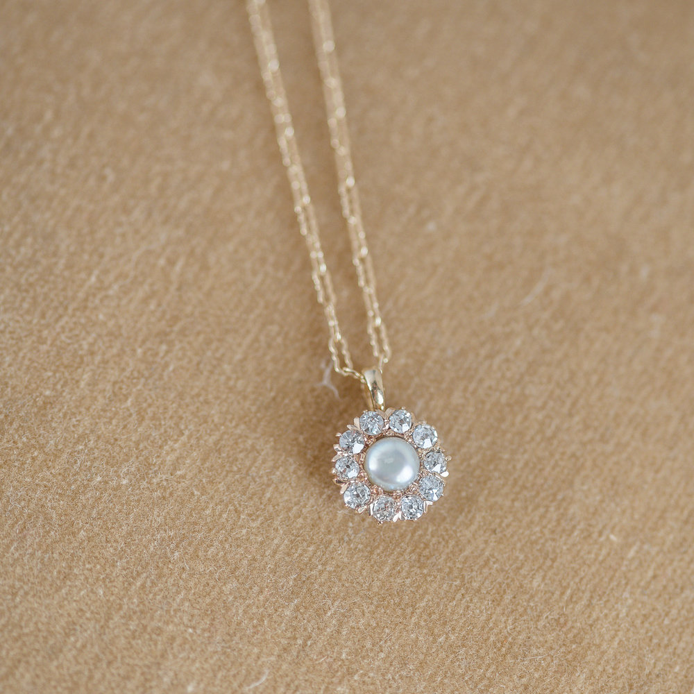 Pearl and Diamond Cluster Pendant. Under $700. What more do we need to say? Shop this beauty  HERE !
