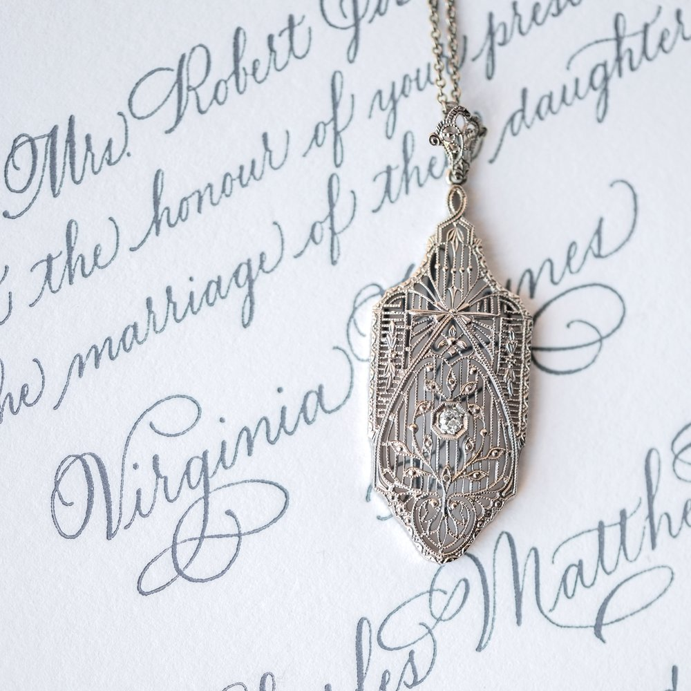 Filigree is like calligraphy with its beautiful flowing lines - and we just can't get enough! Shop this lovely Art Deco diamond pendant  HERE .