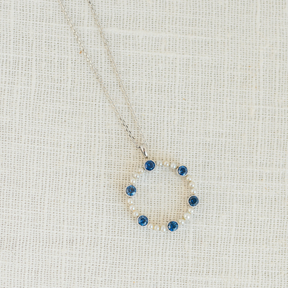 We are loving how simple and bright this lovely little pearl and sapphire pendant is! Shop this piece  HERE !