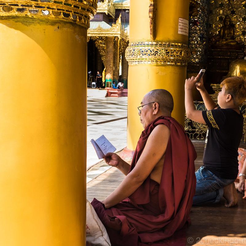 monk_reading_boy_smartphone_shwedagon-pagoda_yangon_myanmar.jpg