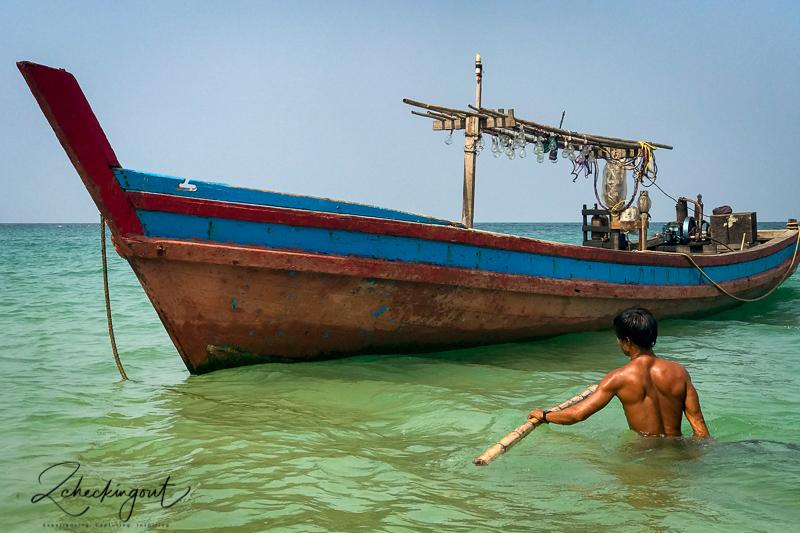 boat_and_fisherman_ngapoli_beach_myanmar.jpg