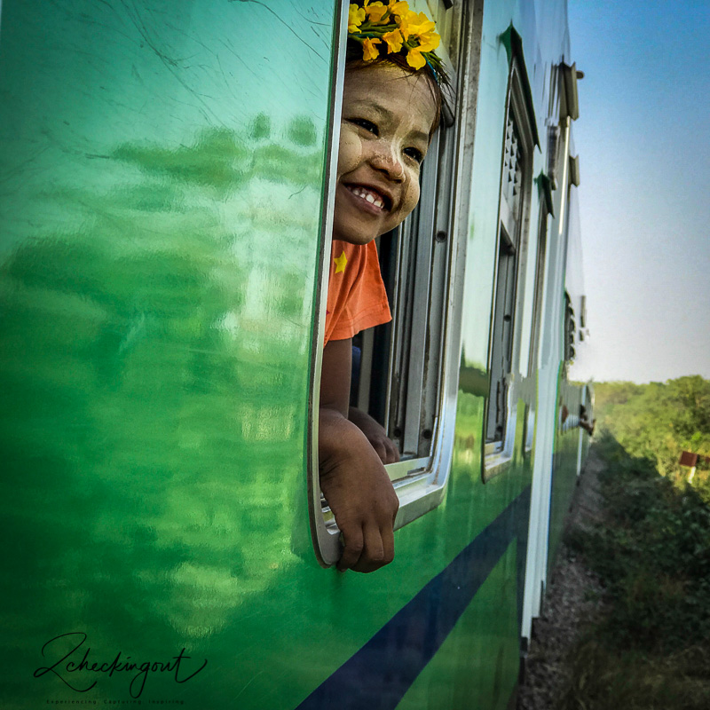 happy_girl_slow_train_myanmar.jpg