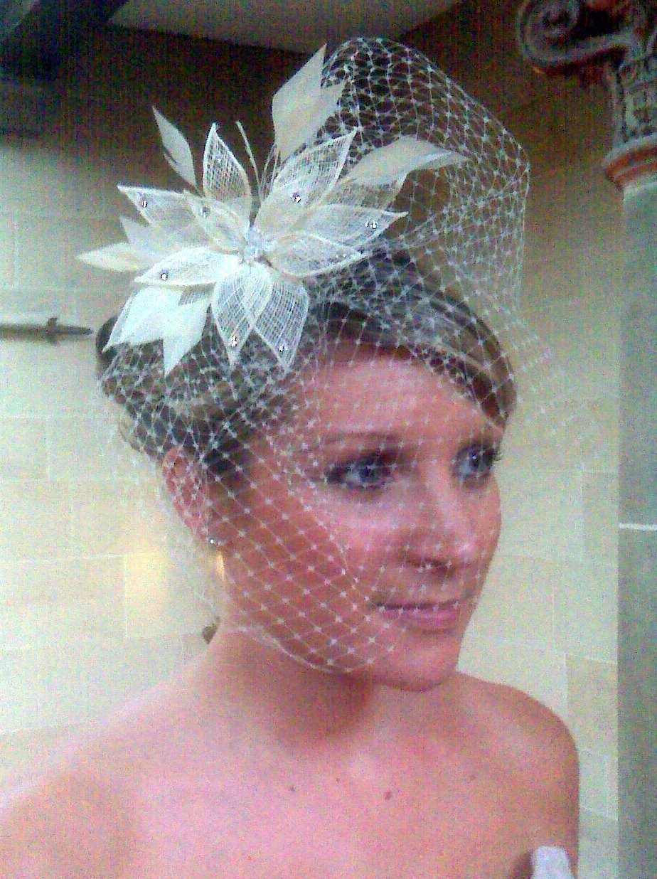 Up do, sweeping fringe, birdcage veil
