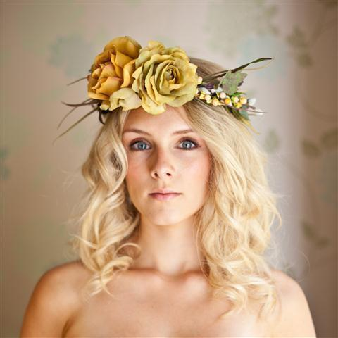 floral halo head band with green and mustard coloured roses/twigs