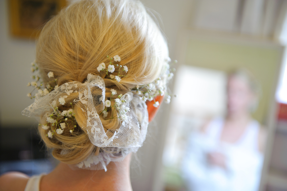 Relaxed wedding hair using Gypsophila and lace. A gorgeous alternative to hair accesories