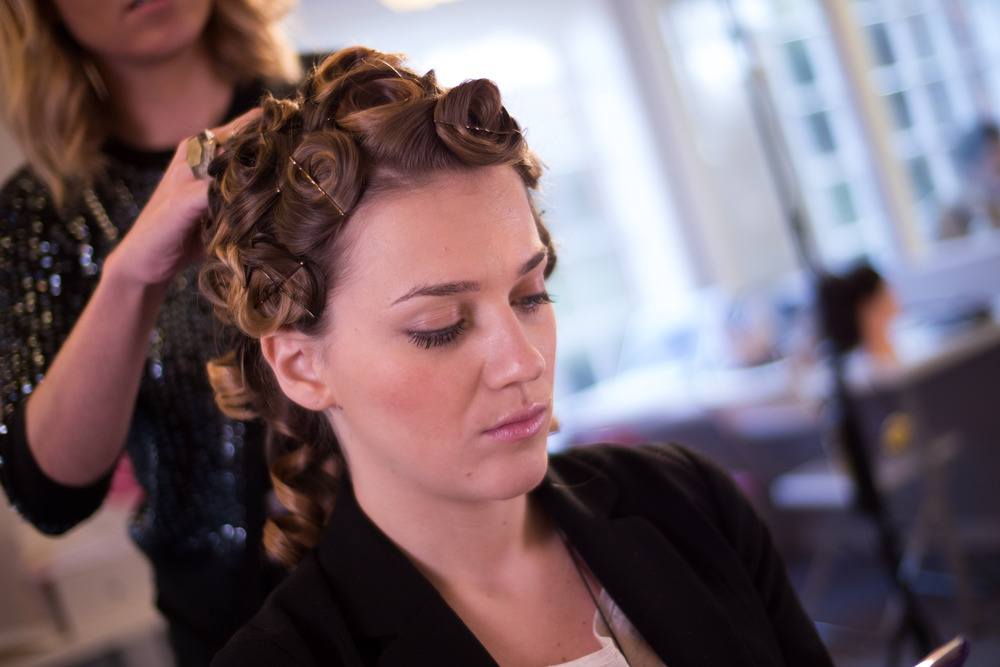 Roll the hair into curls, lie flat and secure with a kirby grip or pin
