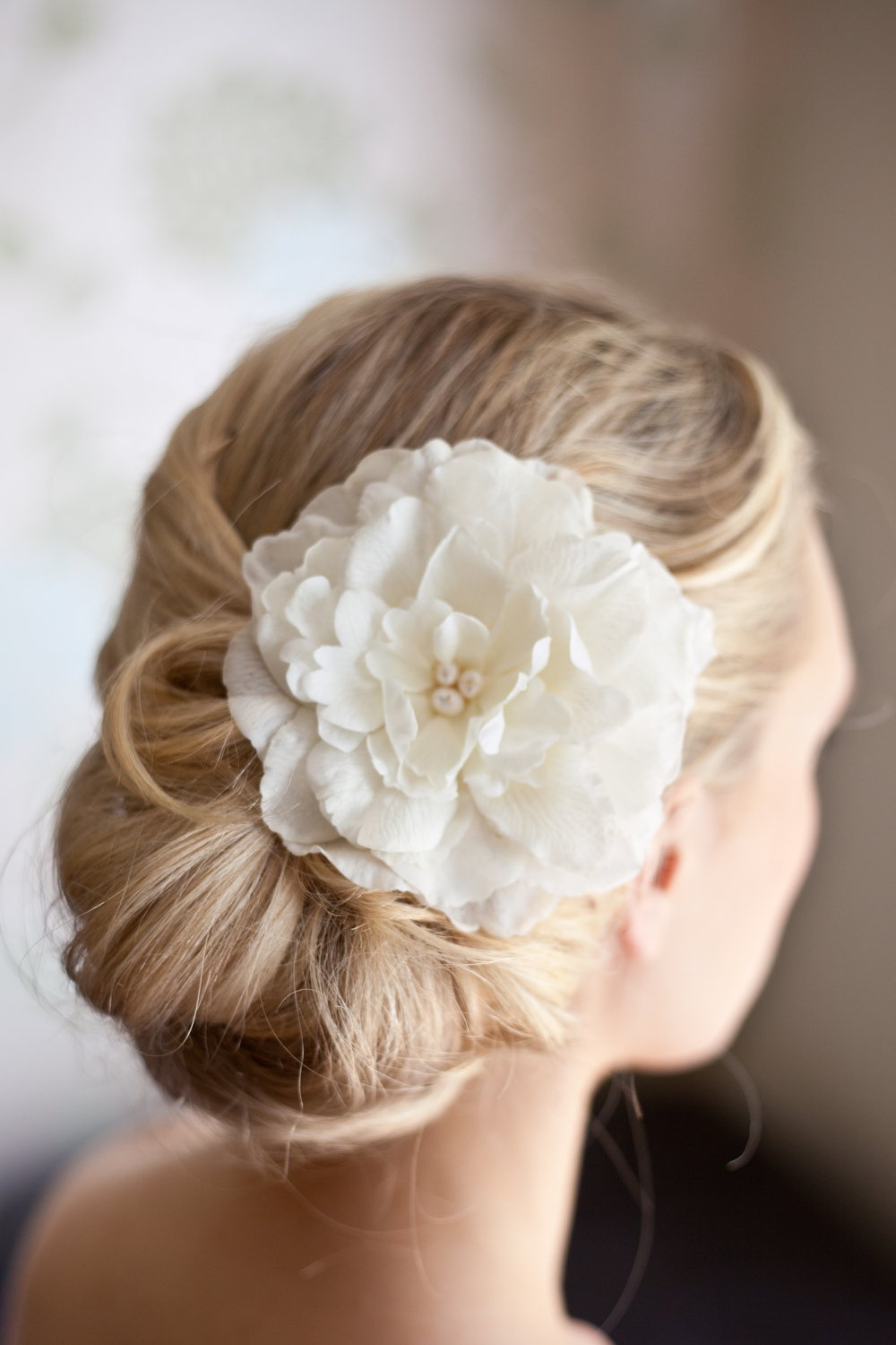 Side Bun With Flower Hair Clip