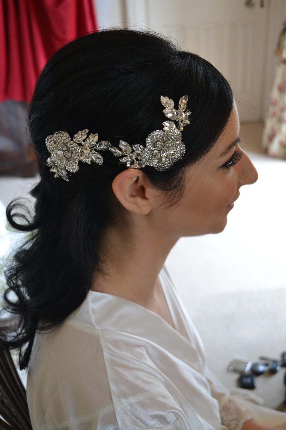 Half up wedding hair with statement hair comb