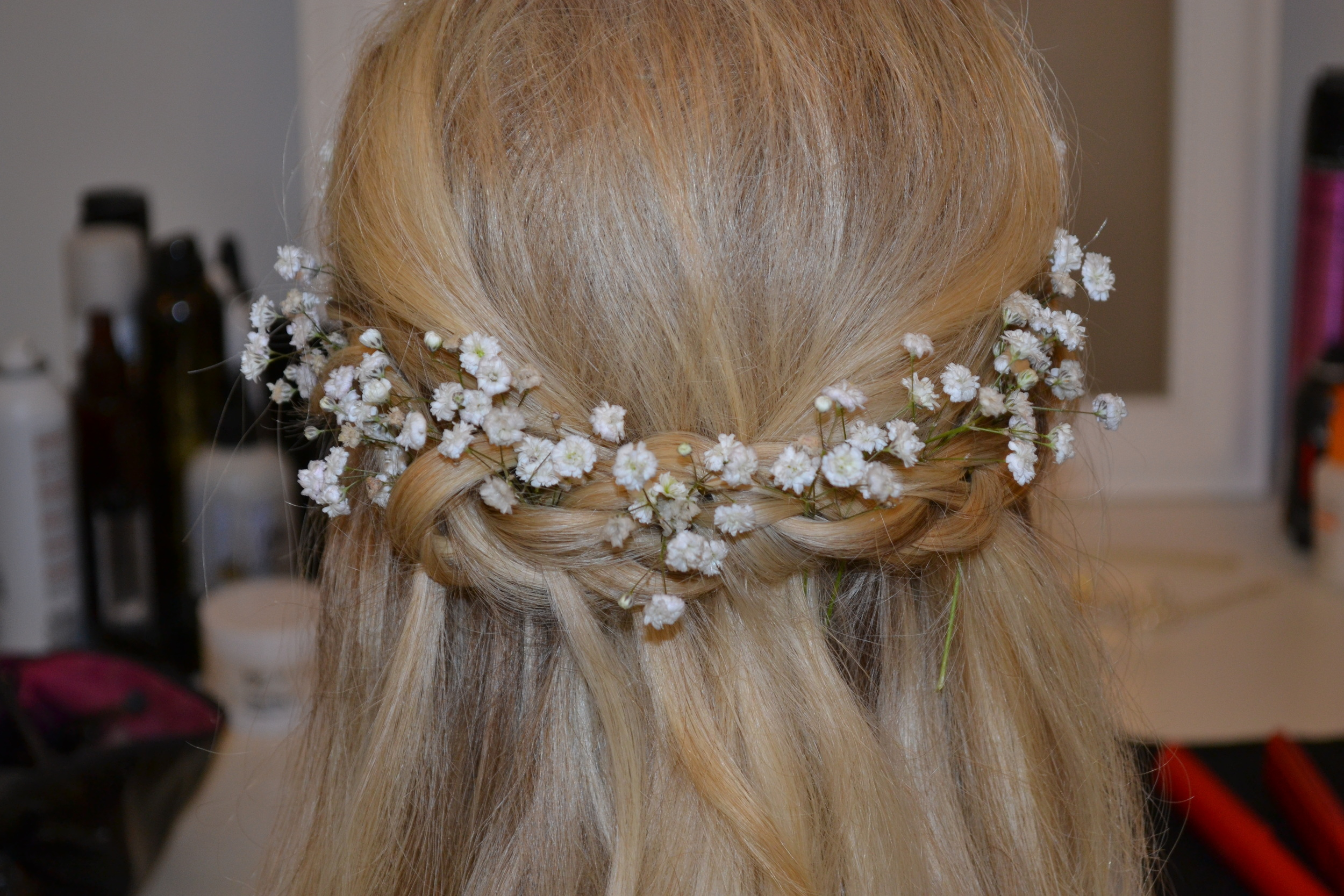 Here Jo Irving has added Gypsophila to create a soft boho look with plaits. This picture was taken at the studio during a hair up course