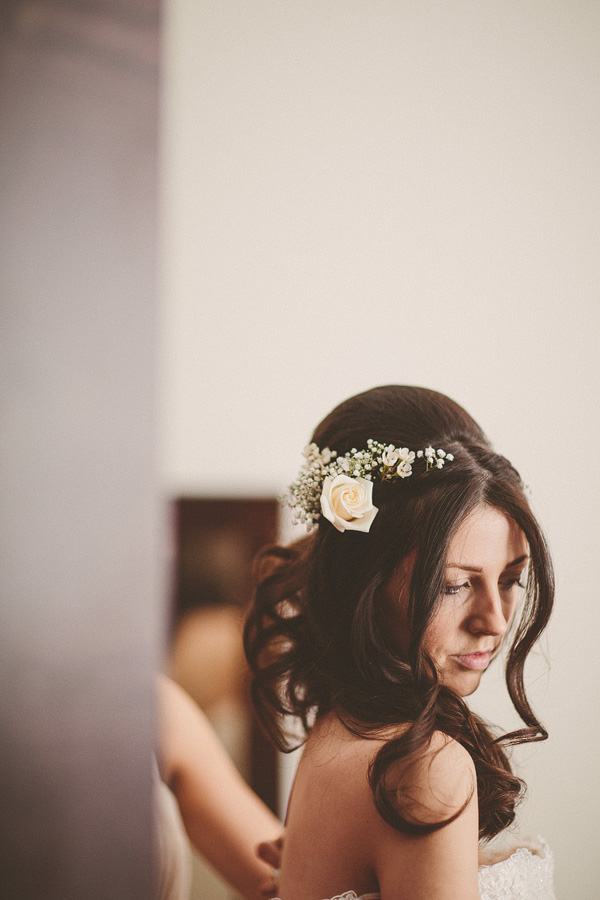 A very ethereal, romantic, fairytale look with loose, long waves and a simple but stunning hair accessory created with real flowers. Hair and make up by Jo Irving at Northbrook Park, Surrey.