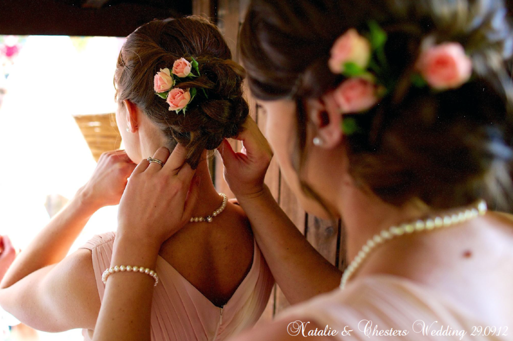 Hair up with fresh coral roses