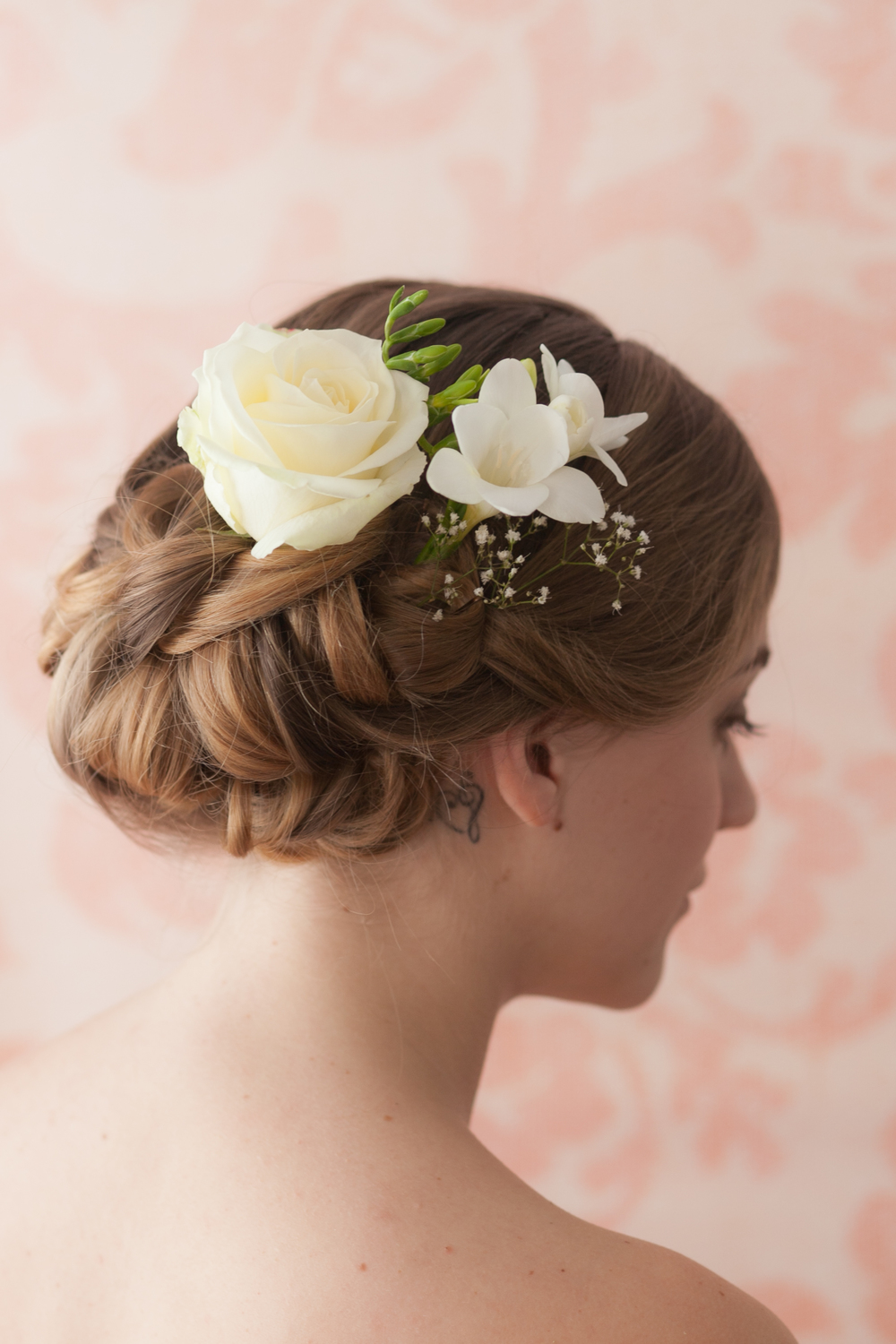 Boho hair up with fresh flowers