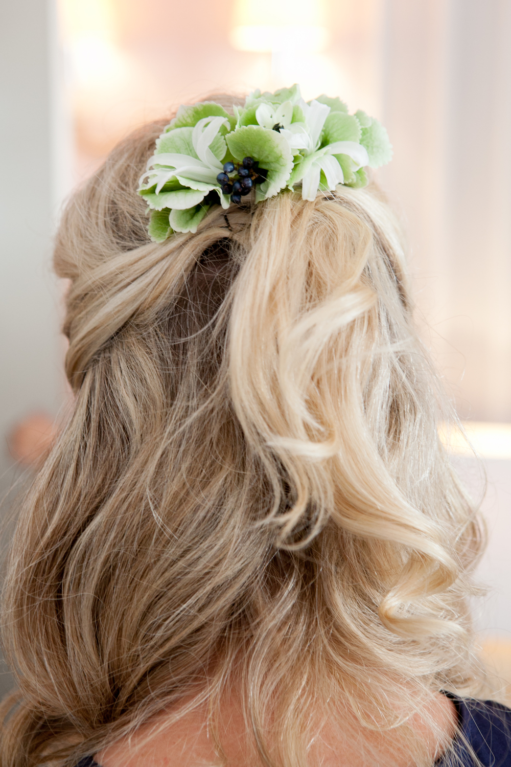 Half up half down bridesmaid hair with flowers