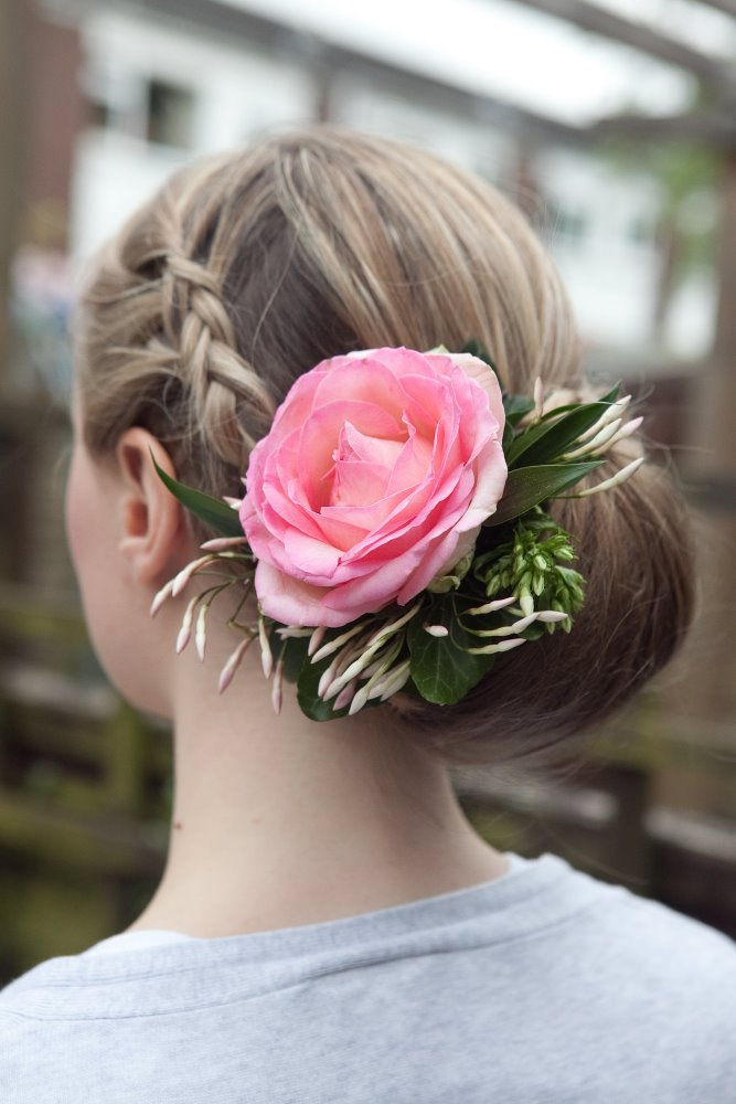 Low bun with plaits and fresh flowers