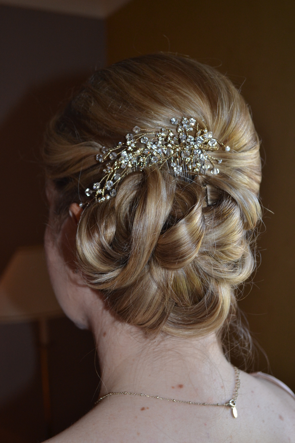Side bun with vintage inspired detail