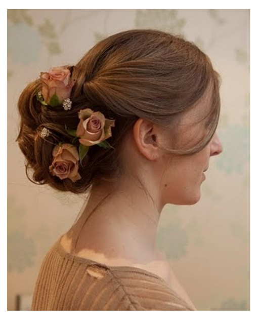 Elegant soft up do with silk flowers