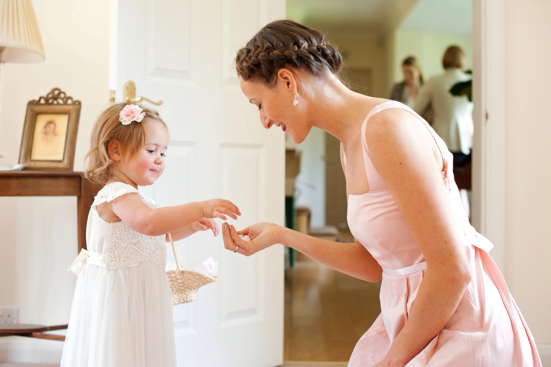 Such a tender moment, cute flower girls showing the bridesmaid her petals..These moments should be remembered forver. Imagine how this little cutie must feel right now? Like a real life princess!