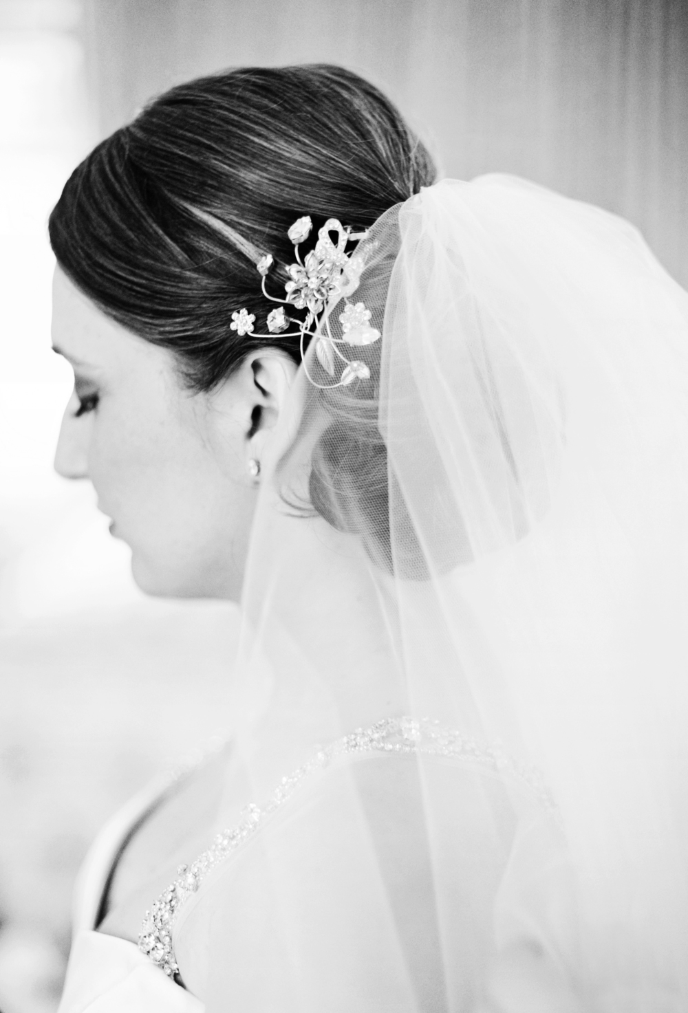 Full low bun with veil and hair comb