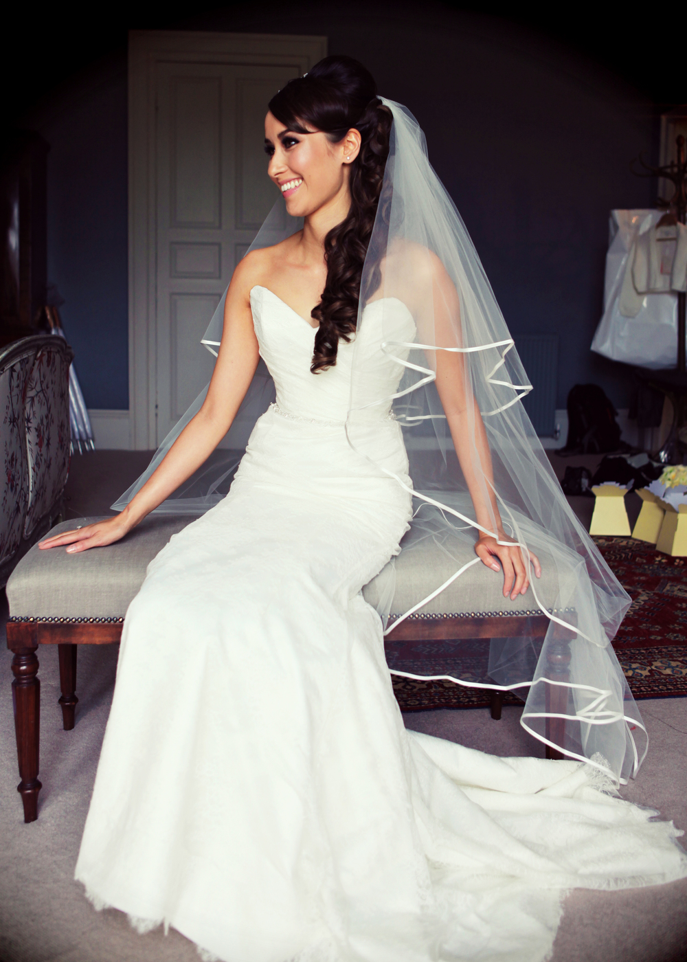 Long veil with hair styled over shoulder