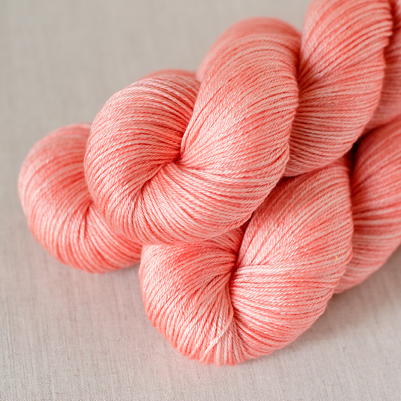 50/50 Fingering - $29 50% SW Merino, 50% Silk Fingering Weight Approx. 435 yards / 398 meters Suggested needles: US 1-5 / 2.25-3.75mm Hand wash, dry flat 50/50 Fingering is a smooth yarn that has shine and extra drape from the silk content.