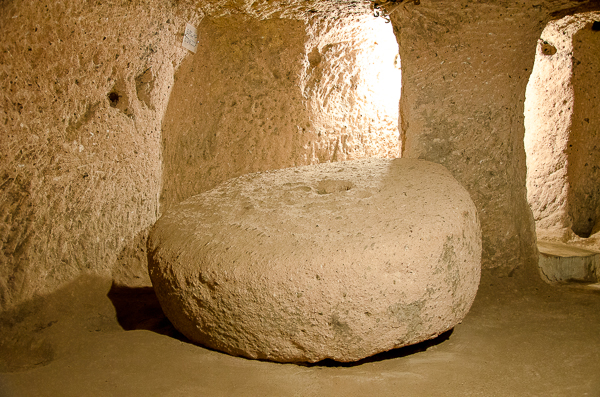 This a stone that blocked a doorway, with hole in middle to provide view of who was 'a knocking.