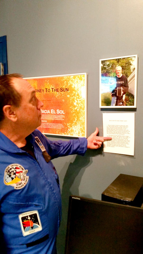 "'JOURNEY TO THE SUN' Fred Welch, Dresser-Rand Challenger Learning Center director, highlights ""Journey to the Sun,"" a gallery of highly detailed photos of the sun taken from ground level in Chautauqua County by photographer Ted Wolfe. The gallery will now be a semi-permanent fixture at the Challenger Learning Center in Allegany and will be available for free at each center in the country."