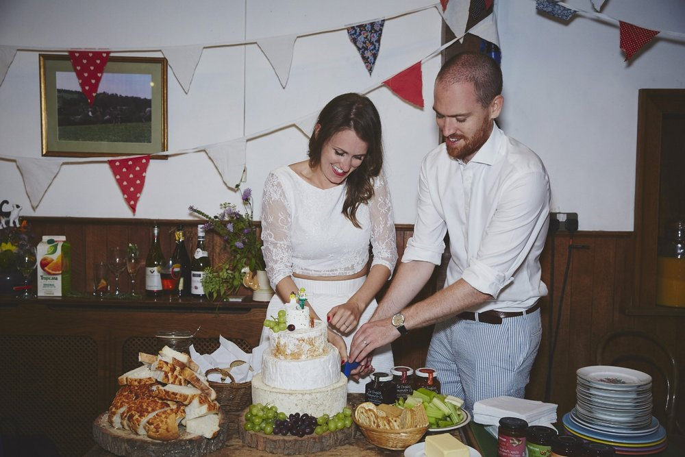 Cheese Wedding Cake | Village Hall Wedding | Sara Lynd Weddings | Alternative, Documentary, Creative Wedding Photographer based in London