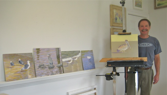In the studio with his bird paintings!