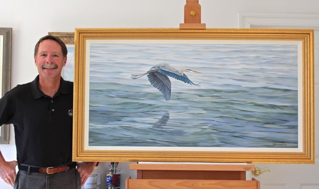 William R. Beebe in his studio in Virginia alongside a commissioned painting in 2015