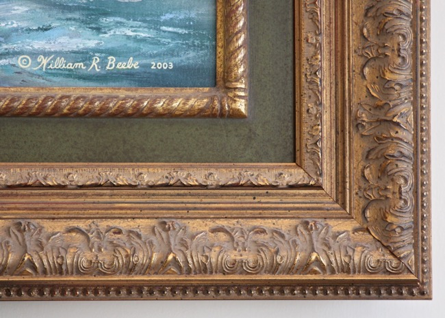 Close-up of frame on The Heritage by William R. Beebe